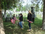 children decorate graves.