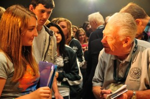 Frank signs autographs at our school.