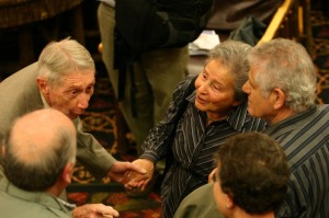 World War II infantry veteran Carrol Walsh, top,meets Holocaust survivors at a reunion in New York State, on Tuesday, Sept. 22, 2009. Walsh's unit liberated a Nazi train carrying 2,500 Jewish prisoners, some pictured here, from the Bergen-Belsen concentration camp in Germany during the war's waning days.The reunion came about because of efforts of high school history teacher Matthew Rozell.