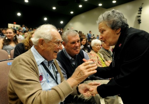 "Holocaust survivor Ariela Rojek, right, was 11 years old in 1945 when she and 2,500 other concentration camp prisoners aboard a train near Magdeburg, Germany, were liberated by American forces including 1st Lt. Frank Towers, left with his son Frank Towers Jr., center. ""You gave me my second life,"" Rojek told Towers Wednesday, Sept. 21, 2011, at Hudson Falls High School during an event reuniting soldiers and survivors. Jason McKibben Glens Falls Post Star"