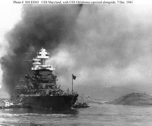 Oklahoma after attack, capsized, right, next to the Maryland.