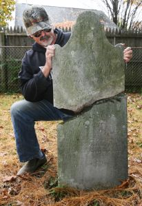Fort Edward historian (and friend) Paul MCarty shows a damaged gravestone for Mintus Northup, father of Solomon Northup, who is buried in Fort Edward, on Monday, Oct. 14, 2013. The Northups lived in the Fort Edward area for many years. A new feature film portrays the freed slave's story from free man to slave and back to a free man. (Derek Pruitt - dpruitt@poststar.com)