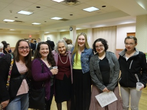 Students Chelsea R., Paige L., Meg V., Cheyenne B., Mary R. flank survivor Clara Rudnick at reception following Yom Hashoah commemoration, 2014.