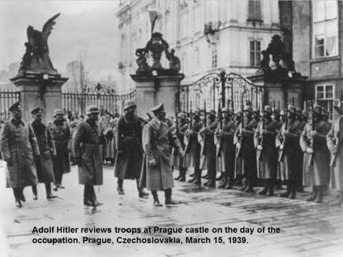 Adolf Hitler reviews troops at Prague castle