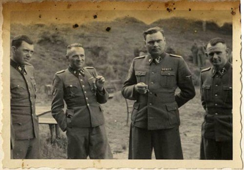 Hocker Album- Dr. Josef Mengele, Rudolf Höss, Josef Kramer, and an unidentified officer. —USHMM