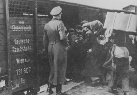 Jews are forced into boxcars destined for the Belzec extermination camp. Lublin, Poland, 1942. USHMM.