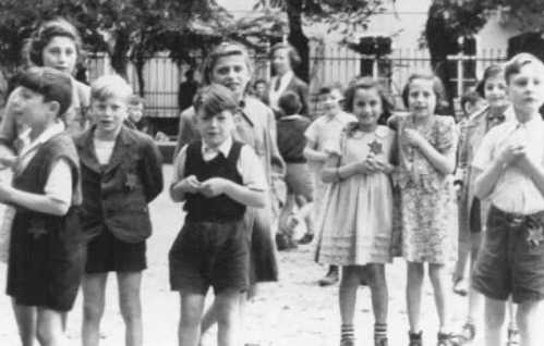 Smiling children during the propaganda visit. Most were sent on to their deaths afterwards. USHMM.