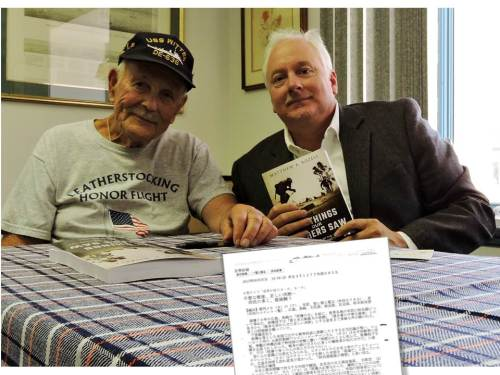 Mr. Peachman and author, at debut book signing, Aug. 8, 2015. Article in Japanese in foreground. Mary Rozell photo.